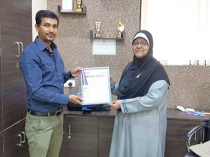 Principal of New Grace English School Receiving Certificate